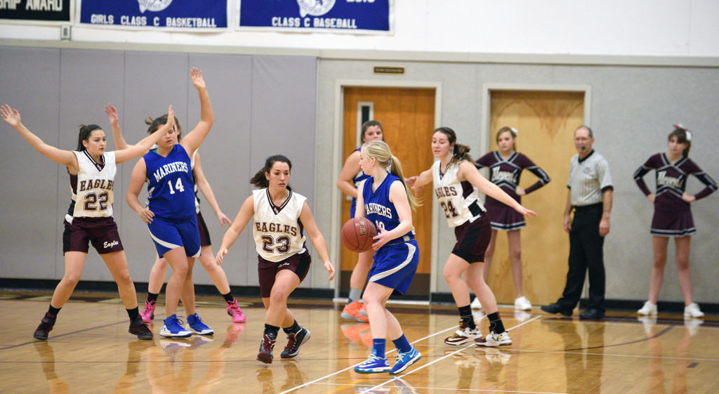 Mariner Holli Boyce faces  the Eagles defense, led by #23 Megan Nowland, when GSA hosted Deer Isle-Stonington on December 23. Photo by Franklin Brown.