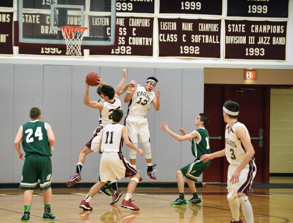 Eagles Finn Davis-Batt steals during a win over  Mount Desert Island on December 19.  Photo by Franklin Brown