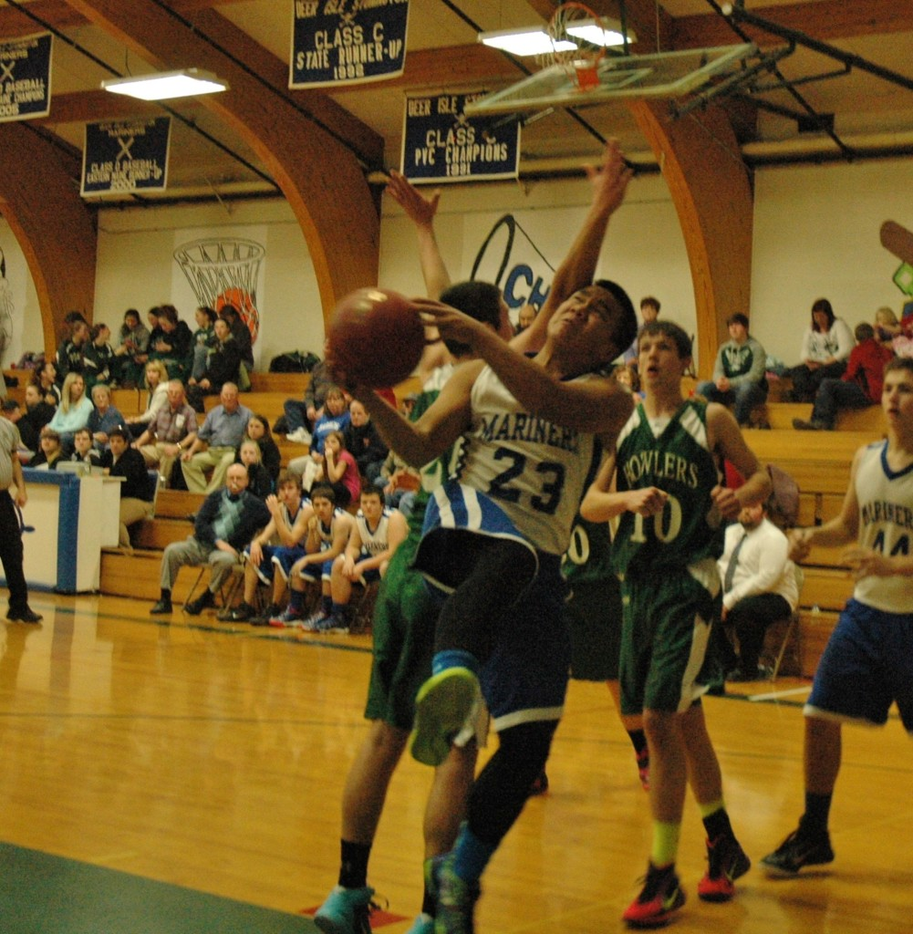 Mariner Krisford Melanio drives down the court against Penobscot Valley on January 3. Photo by jack Scott