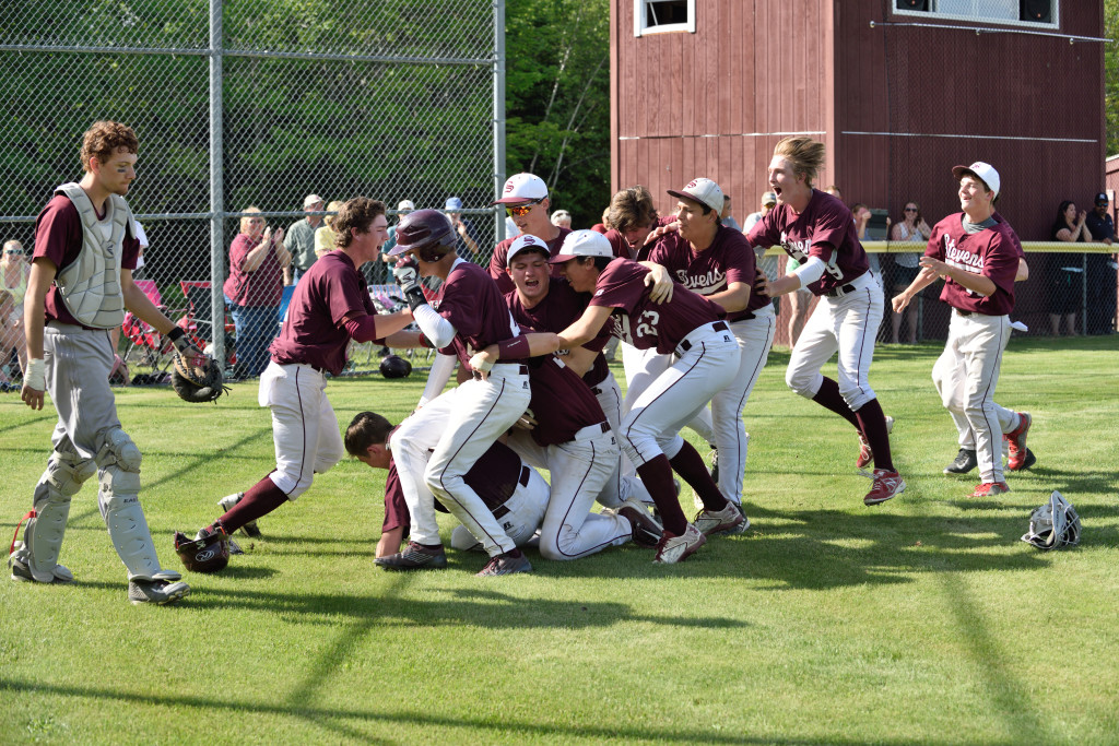 The Eagles celebrate a 10th inning to move to the Eastern finals. Photo by Franklin Brown