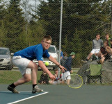Cameron lunges for a backhand return