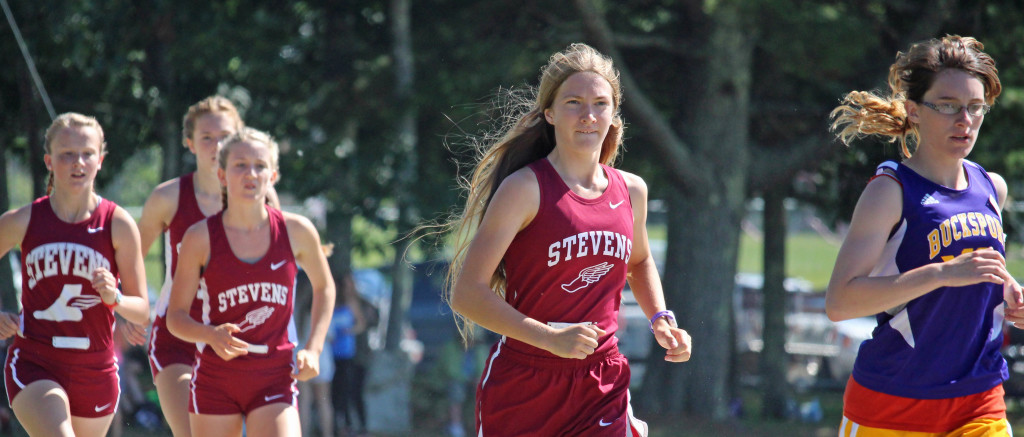 The Eagle girls race cross country at Bucksport Invitational. Photo by John RIchardson
