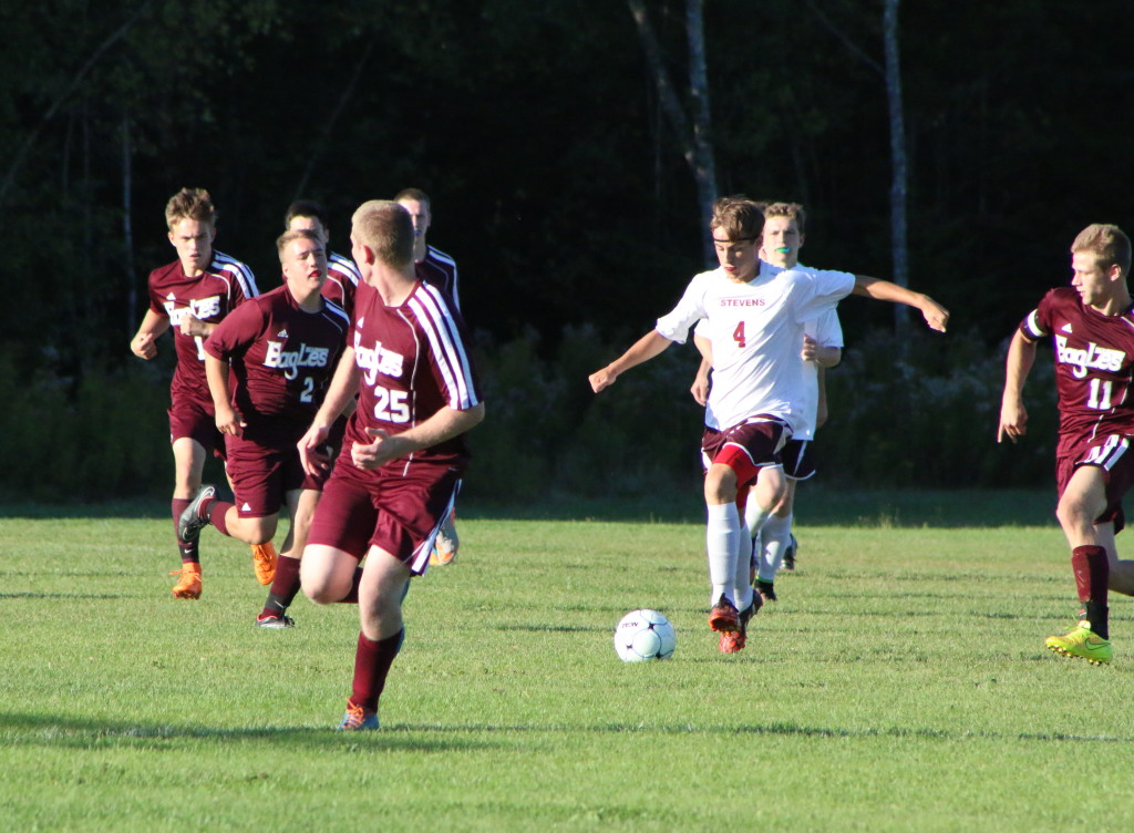 Nick Bianco works the ball against Ellsworth. Photo by Anne Berleant