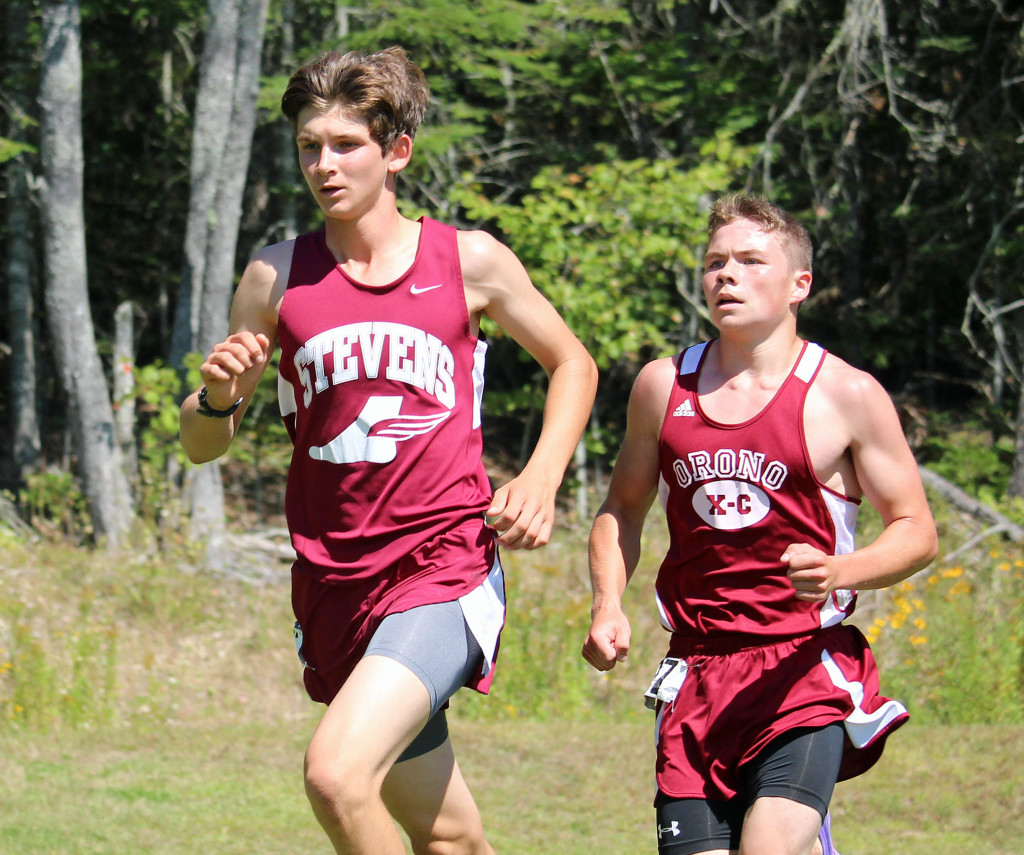 John Hassett races to a first-place finish for George Stevens Academy at the Ellsworth Invitational on September 5. Photo by John Richardson