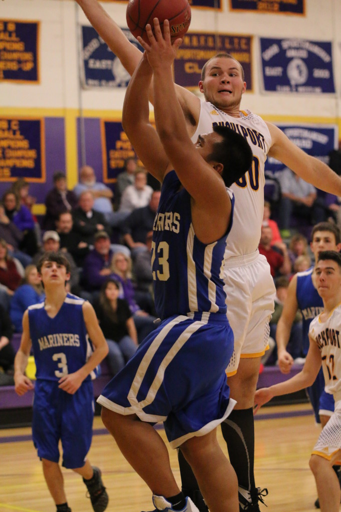 Krisford Melanio shoots for a layup against Bucksport. Photo by Sandra Shepard