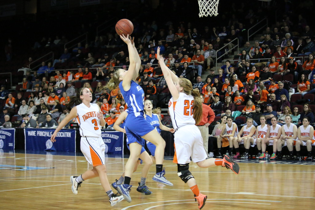 Mariner Natalie Knowlton goes for a lay up at the quarterfinal matchup. PHoto by Anne Berleant
