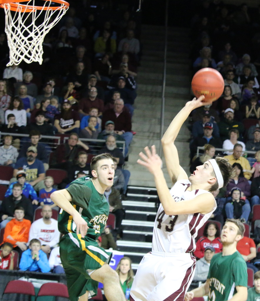 Jarrod Chase lays it up against Fort Kent at the Cross Center. Photo by Anne Berleant