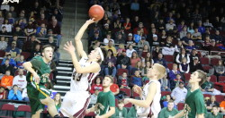 Jarrod Chase lays it up against Fort Kent at the Cross Center . Photo by Anne Berleant