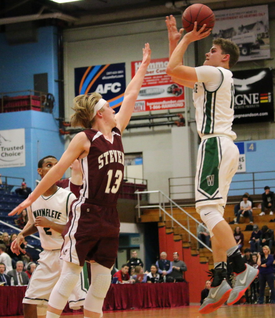 Beckett Slaytons defense forces a missed lay up by Waynflete. Photo by Anne Berleant