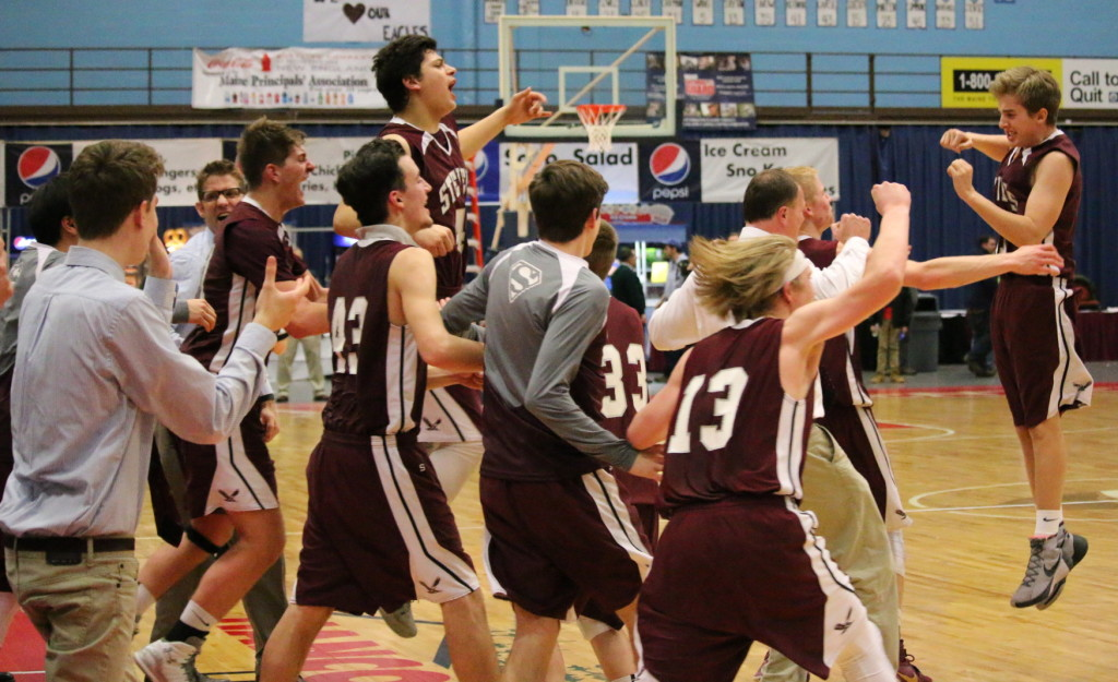 The Eagles storm the floor at the buzzer. Photo by Anne Berleant