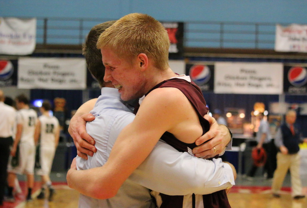 Sophomore Max Mattson celebrates with his father and assistant coach Matt Mattson. Photo by Anne Berleant