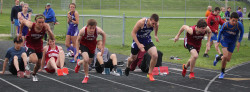 Walker Ellsworth, at left,  competes in the  110 meter hurdle event. Photo by John Richardson