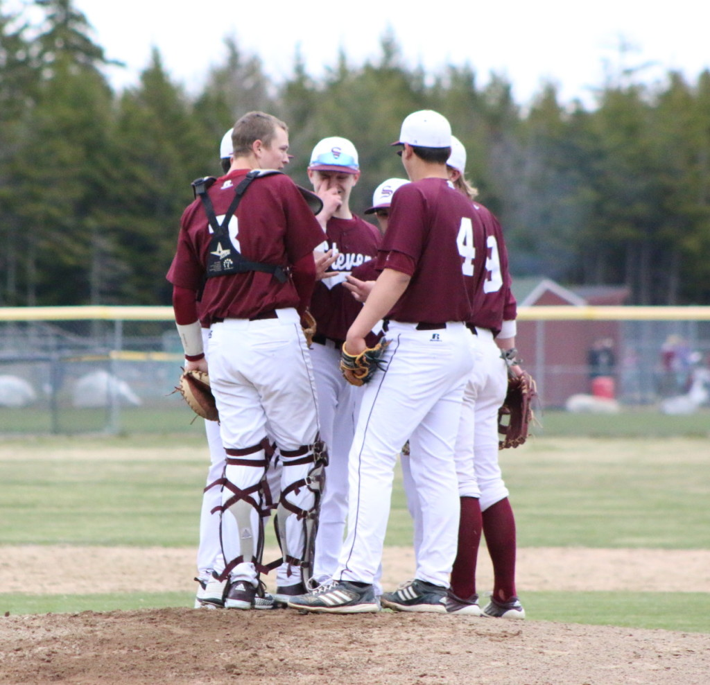 The infield meets at the pitcher's mound. Photo by Monique Labbe
