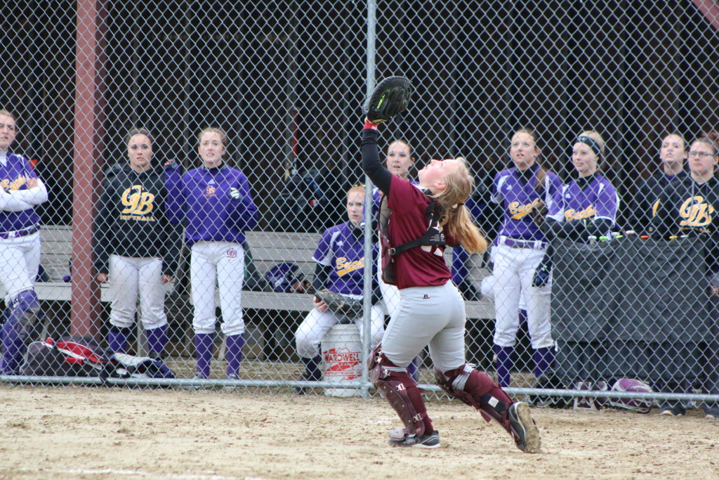 Catcher Sarah Mullen makes a play on an infield pop fly. Photo by Monique Labbe