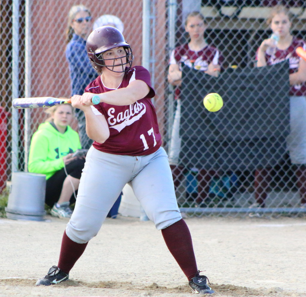 Emma Weed cracks a single down the first base line. Photo by Monique Labbe