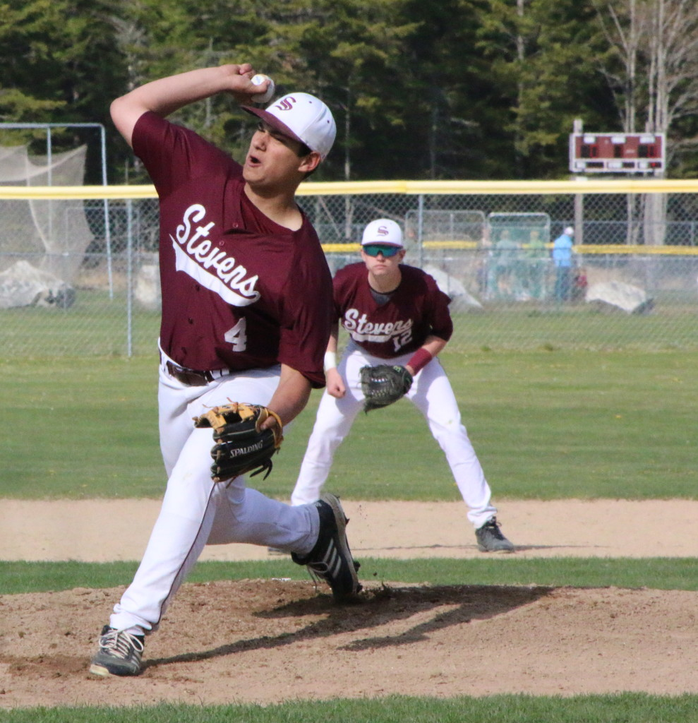 Stefan Simmons throws a fastball for strike three. Photo by Monique Labbe