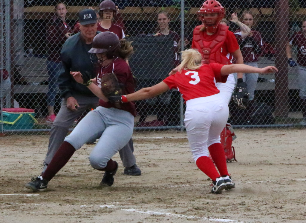 Lily Cox races for home plate against Dexter. Photo by Anne Berleant