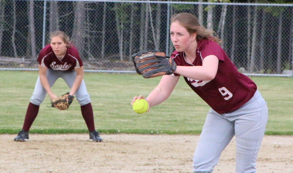 Allyson Snow winds up her pitch, with Katrina Limeburner heding the infield.. Photo by Anne Berleant
