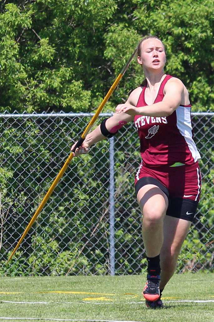 Morgan Dauk repeats her state title in the javelin throw. Photo by John Richardson