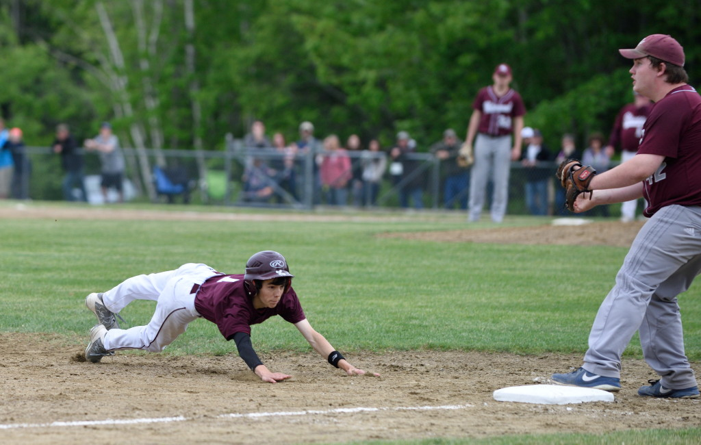 Nick Norton dives for third base in the sixth inning of the semifinal.  Photo by Franklin Brown