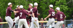 The Eagles  celebrate their semifinal win over Mattanawcook Academy after outing them in the top of the 7th inning.  Photo by Franklin Brown
