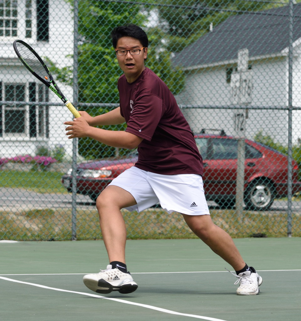 Doubles player Kent Fang  returns against Fort Kent.  Photo by Franklin Brown