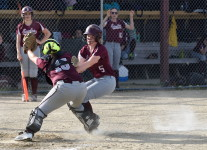 Katrin Cote races for home plate against Washington Academy.  Photo by Franklin Brown
