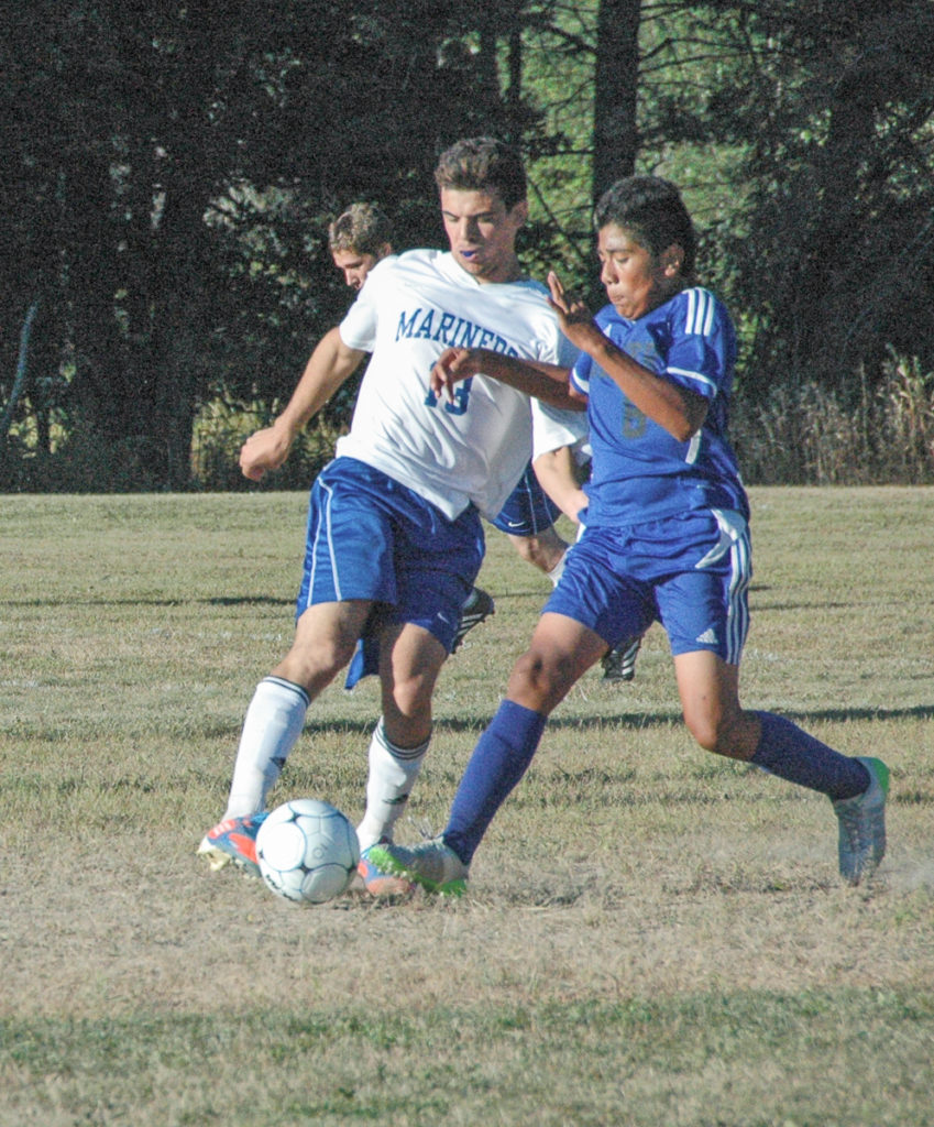 Mariner Arthur Valente turns the ball against Searsport. Photo by Jack Scott