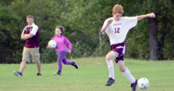Ethan Vinall heads off a kick. Photo by Anne Berleant