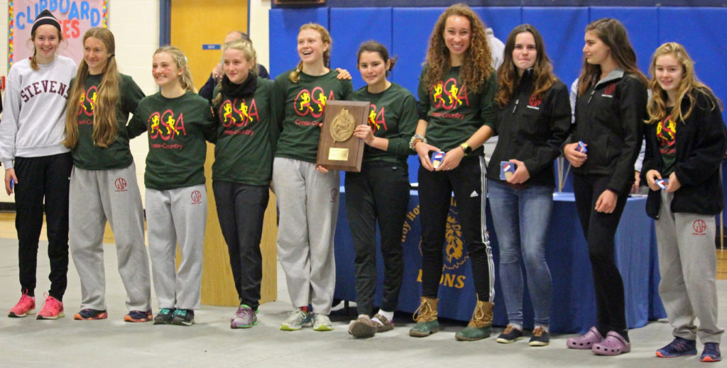 The George Stevens girls cross-country team brought home the Northern Regional Championship on Saturday, October 29. Photo by John Richardson