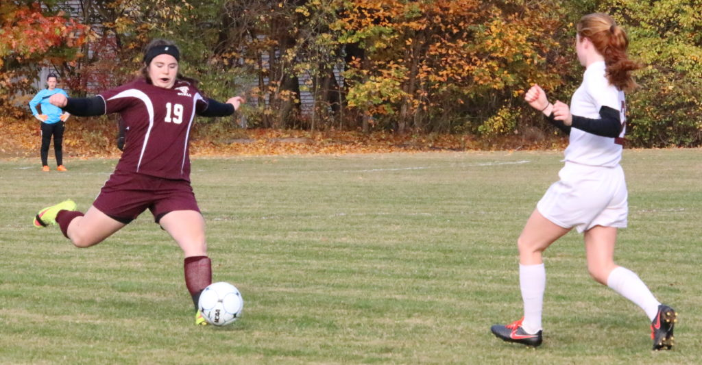 GSA defender Mallory Charette clears the ball out of the backfield. Photo by Monique Labbe