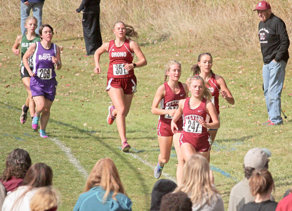 Mary Rich races the 3.1 cross country course