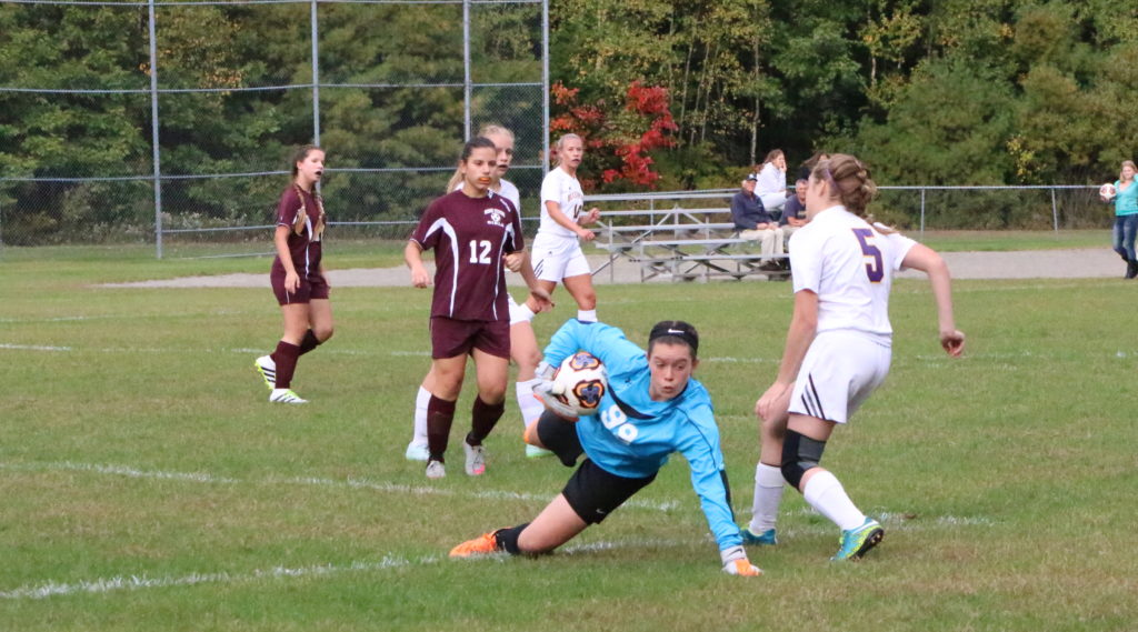 Goalkeeper Bess MacArthur saves 10 of 18 shots twoards the win. Photo by Anne Berleant