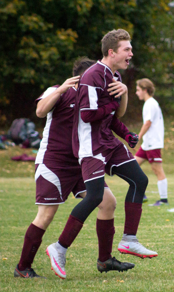 Taylor Schildroth celebrates his third goal, completing a hat trick, with Tyler Snow. Photo by Tate Yoder