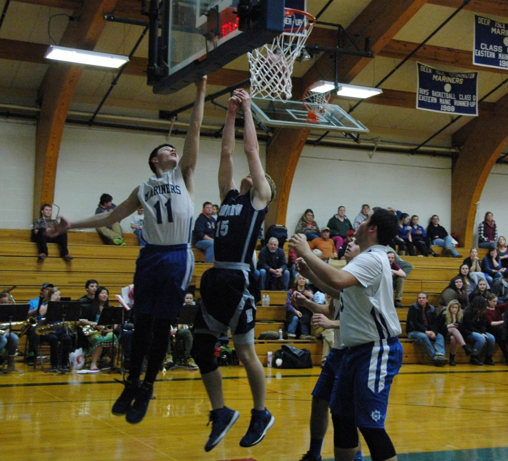 Ethan Bates Coles reaches for the layup against HIghview Christian. Photo by Jack Scott
