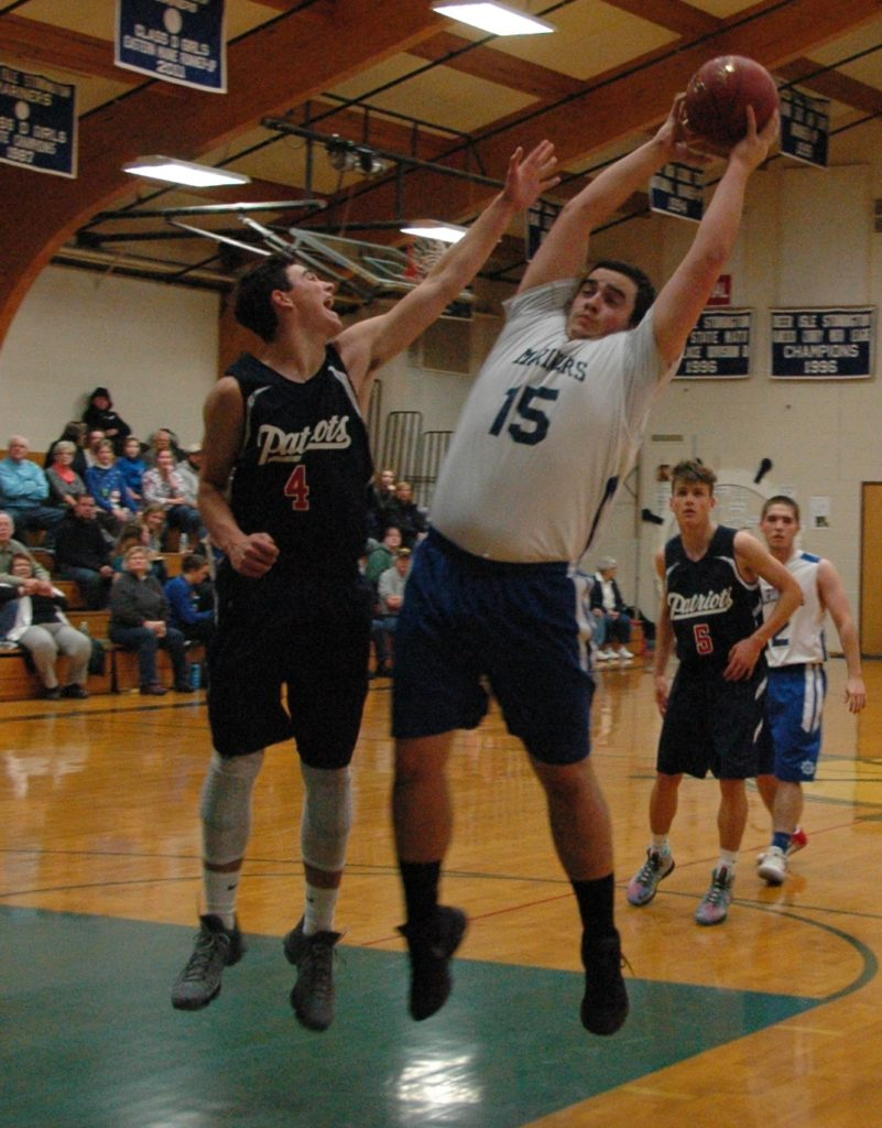 Ethan Shepard gets the rebound against Bangor Christian. Photo by Jack Scott