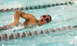 Alexander Yap swims the men's 50 Yard freestyle. Photo by Franklin Brown