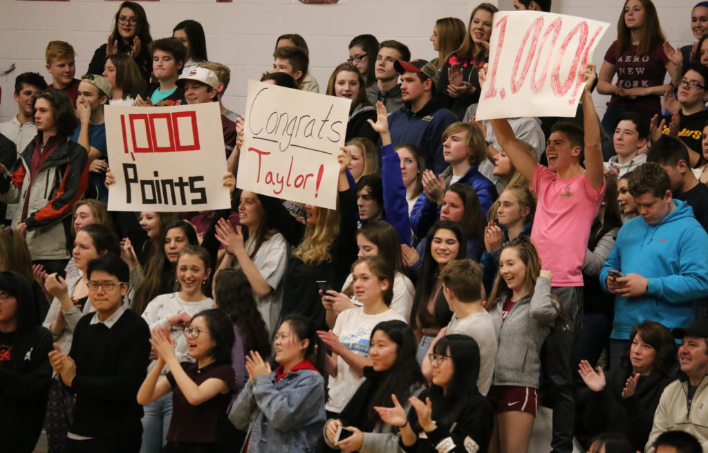Fans react to Taylor Schildroths 1,000th point. Photo by Anne Berleant