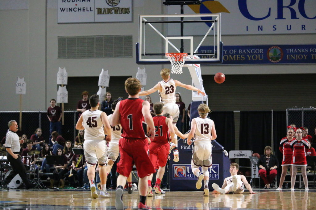 Max Mattson blocks a shot by Fort Fairfield. Photo by Anne Berleant