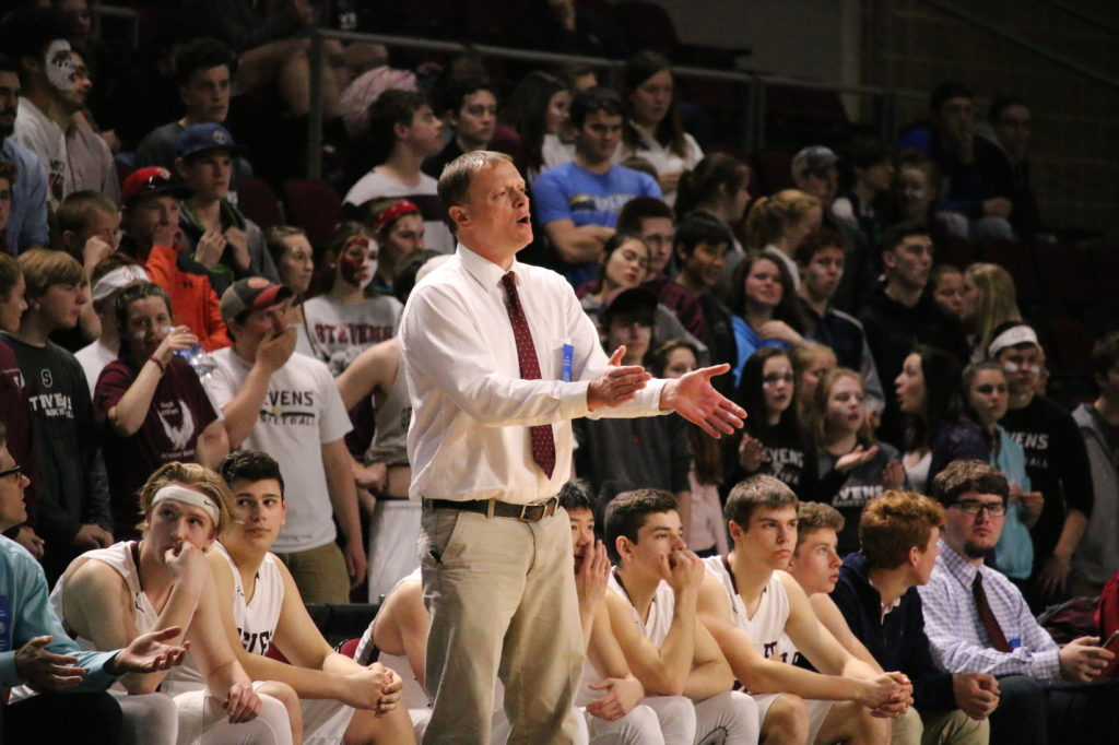 Coach Dwayne Carter pushes his team from the sidelines. Photo by Anne Berleant
