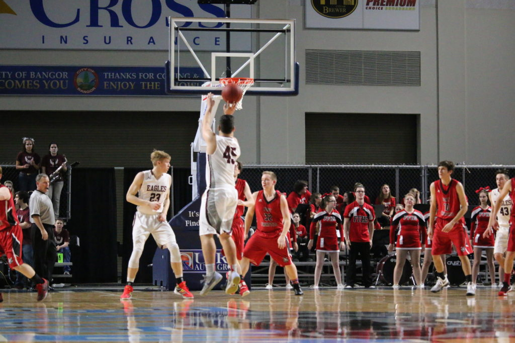 Stefan Simmons scores a three pointer in the third quarter. Photo by Anne Berleant