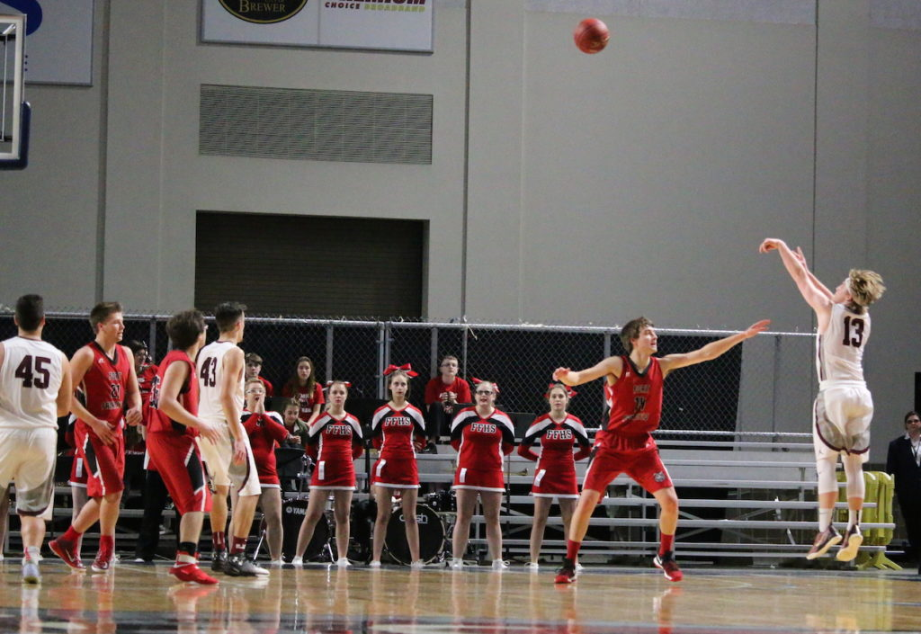 Beckett Slayton scores from beyond the three-point line. Photo by Anne Berleant