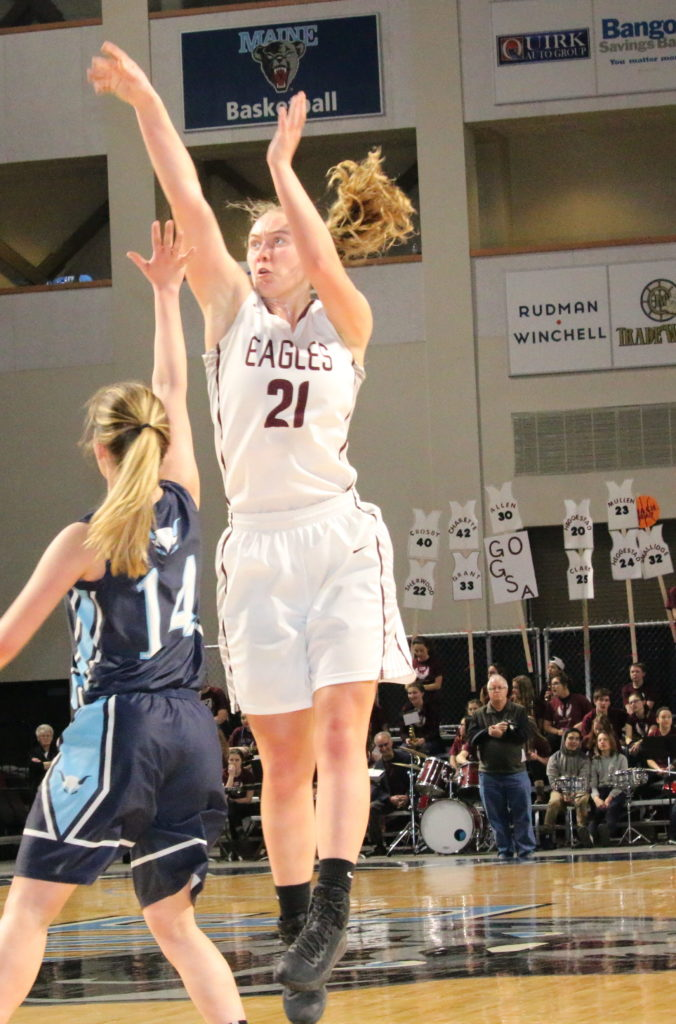 Morgan Dauk knocks down a jumper. Photo by Monique Labbe