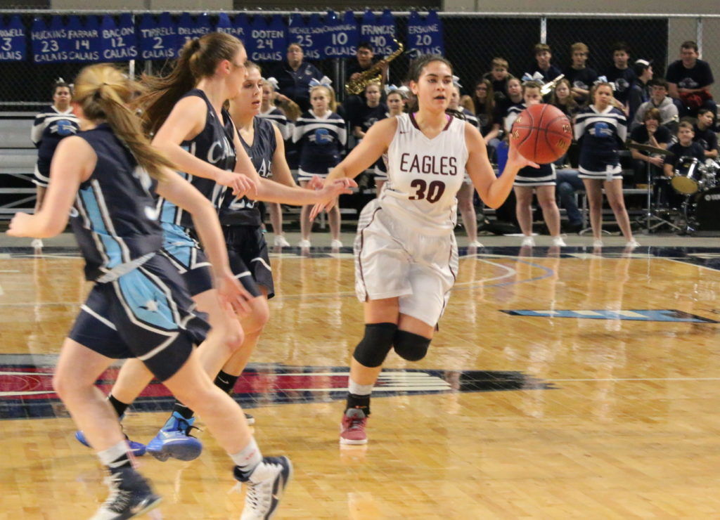 Julianna Allen brings the ball up the floor. Photo by Monique Labbe