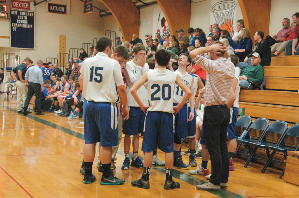 Coach Rufus Nicoll rallies the team against Jonesport. Photo by Jack Scott