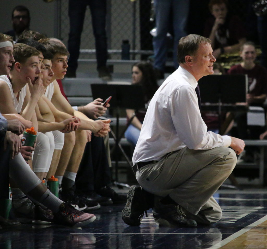 Coach Dwayne Carter reacts to a call. Photo by Anne Berleant
