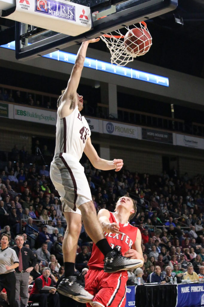 Jarrod Chase takes the dunk. Photo by Anne Berleant