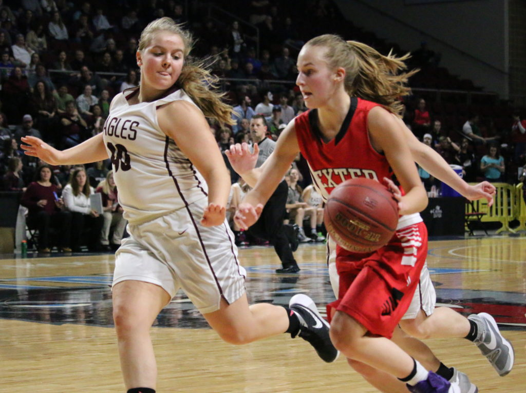 Emma Crosby works the Eagle defense in the final seconds of play. Photo by Anne Berleant