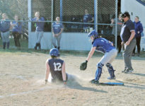 Lily Gray tries to beat a slide into home plate. Photo by Jack Scott