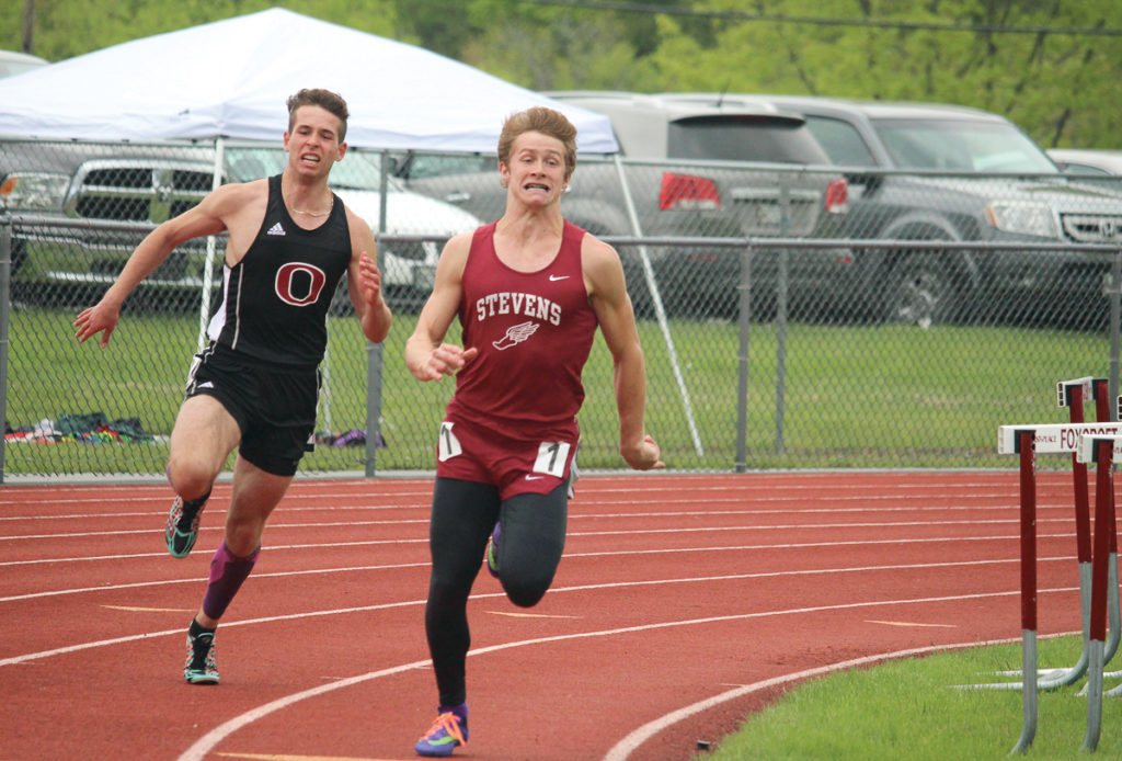 Cameron Gordon runs the 400 meter dash